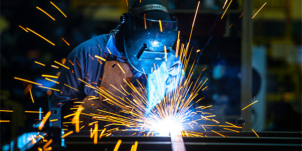 man welding metal